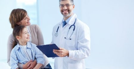 happy-doctor-holding-clipboard-with-patients_1098-2176